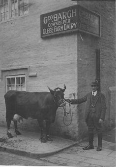 George Bargh, Cowkeeper in Liverpool, outside dairy in Walton
