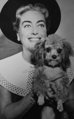 Joan Crawford and her poodle- just think what crazy that poor dog witnessed in it's life lol