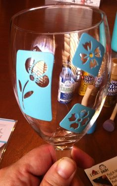 Choose your peel and stick stencils and stick them where you want them on the glass. Diy Wine Glasses, Decorated Wine Glasses, Hand Painted Wine Glasses, Painting On Wine Glasses, Wine Glass Crafts, Wine Craft, Wine Bottle Crafts, Glitter Wine Bottles, Jar Crafts