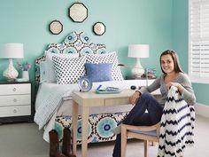 Emily's Favorite Room  - Full House: A Favorite Room for Everyone on HGTV  Navy is her favorite color-, but since four dark blue walls can make a room look heavy, she decided on teal instead (Sea Mist Green by Benjamin Moore) with navy accents.