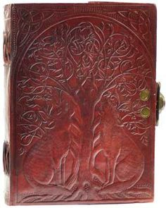 """Hand tooled blank leather journal with heavily embossed covers showing wolves and a complex knot work forming a Tree of Life. Sizes vary slightly. Leather, handmade paper. 220 pages, latch closure. 5"""""""