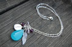 Teal Imagine Feather Charm Necklace IMAGINE by justanillusion, $18.00