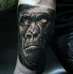 Inner Forearm Mens Tattoo Of A Gorilla In Black Ink With Orange Eyes