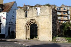 """West Door of Old St James the Apostle Church Ruins, Dover, Kent, England, UK:  Known as Dover's """"Tidy Ruin"""" after damage by shells during the 1939-1945 World War II. Now a memorial to the townspeople of that time. Church originally Saxon and then Norman. The doorway was plain until pseudo-Norman carvings were added in 1869 Victorian restoration. More information at http://www.panoramio.com/photo/80269935 Urban Church Architecture and History."""