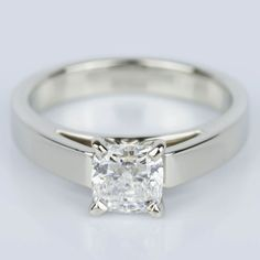 A stunning recently purchased Cathedral Solitaire Cushion Diamond Engagement Ring!