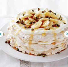 Banana Cream Pavlova Tower~   Pavlova is one of Australia's most beloved desserts, and this one -- composed of stacked meringues, bananas, and pistachios -- explains why.