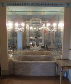 Mrs Vanderbilt's bathtub at Eagles' Nest - notice the crystal sconces on mirrored surround - marble tub.
