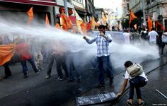 Turkish riot police use water cannon to disperse protesters during a demonstration against new Turkish President Recep Tayyip Erdogan in Istanbul - 28 August