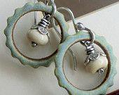 Lavender Amethyst and Dark Purple Glass Earrings Antiqued Copper Wire Work. $32.00, via Etsy.