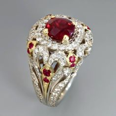 This elegant antique style ring holds a Burmese certified pigeon blood #ruby surrounded by diamonds and rubies in 18k gold by Alex Gulko