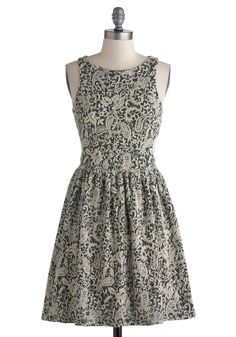 Savvy Chic Dress ($74.99 at Modcloth.com) This ornate paisley dress suits any elegant scene! Embellished with cute cutouts on each side and a silky smooth full lining, this fancy frock of ivory and charcoal complements your cunning frame with its classic A-line silhouette.