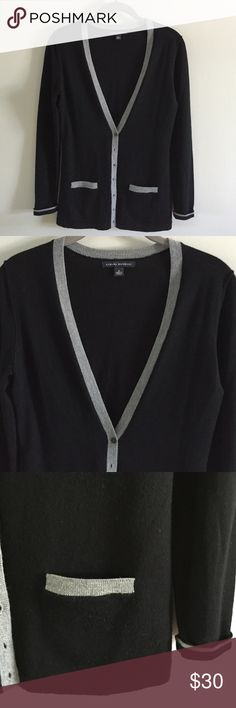Banana Republic Merino Cardigan 100% merino wool finely knit v-neck cardigan. Black with heather gray trim. Front pockets and cuffed sleeves. Excellent used condition. No snags, pills or holes. Banana Republic Sweaters Cardigans