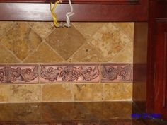 tile backsplash for kitchen with copper accents ties into copper sink
