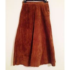"Vintage 70s Festival Suede Maxi Skirt Boho XS Great on trend vintage brown suede maxi skirt from JH Collectibles. Lined and with side mother of pearl buttons. Great find. Waist flat is about 13.5"". Very Free People! Length is 33-34"" JH Collectibles Skirts Maxi"