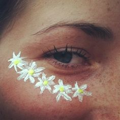Flower's on your face through paint makeup stickers or glue