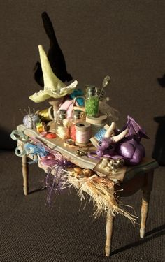 Witch's hat making table in miniature by Dreamkeeperfae on etsy