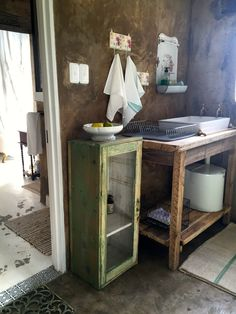 Green cupboard from Yesterday's, Vintage enamel holder from Fieterjasies, Wash basin table from Kikis Vintage Studio