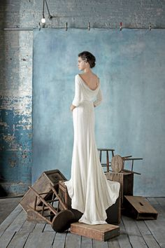 Dress by Dennis Basso for Kleinfeld. Modest long sleeve wedding