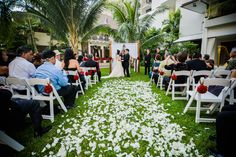 A decorated aisle at the famous Halekulani.   See more of this fab wedding: http://modernweddingshawaii.com/kristy-sage-oahu-hawaii-real-wedding/