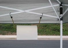 Tailgating idea ... Hang a paper towel roll using a bungee cord from the tent struts.