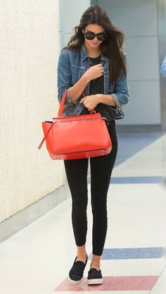 Kendall Jenner. #panchas black flat loafers, denim jacket, red bag, black pants, black shirt