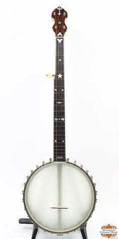 """A stunning banjo from the A.C. Fairbanks Company, from the second owner. This is a fine player's, collector piece. The wooden rim is 10-3/4"""" in diameter and fitted with the fabled electric/Whyte Laydie tonering. It is painted back with white binding on the lower edge. The neck has a husky feel to it and is mahogany with some attractive inlayed pearl.  In excellent conditon, some fret wear, cracking on peghead overlay. Superior tone and playability. Newer Harptone case included in the sale."""