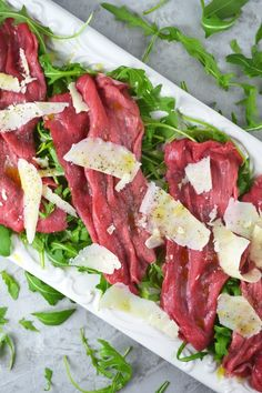 Beef Carpaccio is a classic Italian salad made with beef fillet, arugula, parmesan, lemon and olive oil. Get the recipe here.