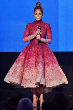 See All 10 of Jennifer Lopez's Amazing Ensembles from the 2015 AMAs - Pretty in Pink - from InStyle.com