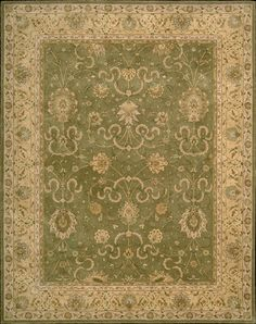Heritage Hall HE20 Green rug. Inspired by the elegant Persian carpets of old, this signature collection makes a timeless traditional statement. To achieve the unmistakable vintage look, premium quality wool is hard-twisted, specially woven and dyed to replicate the colors of ancient vegetable dyes. The extraordinarily dense construction creates an incomparable and durable texture that will ensure years of lasting beauty.