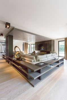 Beautiful sofa in U shape layout with cabinets surrounding