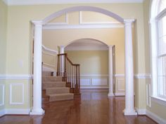 Love the hardwoods, the stairs, and the arches!