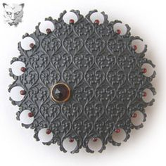 Piece item c Ornate Pattern Brooch 2006 Round, hand-pierced brooch with decorated surface. £600 Dimensions: 70mm x 70mm Photographer: Marianne Anderson