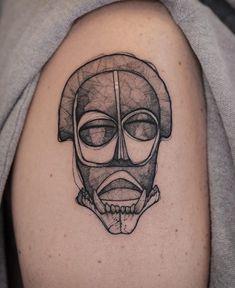 African mask Done by Tom Chili Pepper at Moving Tattoo Cie in Montreal CA Mask Tattoo, R Tattoo, Moving On Tattoos, Modern Tattoos, African Masks, Tattoo Designs, Tattoo Ideas, Mini Tattoos, Best Artist