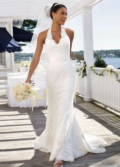 David's Bridal Wedding Dress: Allover Beaded Lace with Illusion Halter Neckline, $399.99 The lace halter is a nice alternative to strapless, and it features a traditional train.