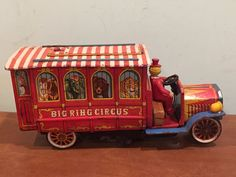 """Vintage battery operated tin toy Big Ring Circus wagon made by Modern Toys in Japan c. 1960s. Measures about 6"""" tall, 12.5"""" long, and 4.25"""" wide. It does not work. There is some corrosion/rust on some of the electrical contacts, so I assume that is the problem, but there may be other issues as well. Selling as is, for use as a decorative piece or for parts or repair. Otherwise, condition is as seen in photos. Scratches, discoloration, and other vintage wear. Please ..."""