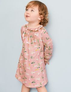 Ideal for play dates or the park, this sweet little dress has a sueded finish which feels lovely and soft against baby's skin. Featuring a ruffle collar for extra daintiness, it's finished with poppers down the back for easy costume changes (phew).