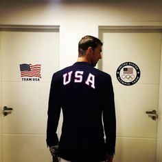 Michael Phelps prepares to carry the flag for Team USA at the Opening Ceremony for the Rio Olympics August 5, 2016.