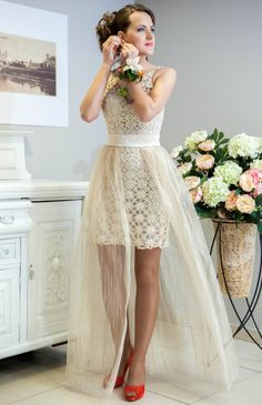 I saw this picture from a site where they design and create to sell wedding dresses. They don't provide a pattern but if you take a dress and add organza fabric...you can have a dress similar to this. If you add color to it, it can be a design for your bridesmaids dresses. Beautiful idea! :)