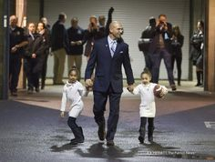 PENN STATE – FOOTBALL 2014 – James Franklin and his daughters Shola, 6 and Addy 5 head out to the field after he was officially introduced as the new Penn State football coach during a news conference at Beaver Stadium. Franklin replaces Bill O'Brien who left for the Houston Texans on December 31, 2013. Joe Hermitt, PennLive