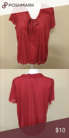 Polka dot blouse Elastic band on the bottom. Ties in the front Tops Blouses