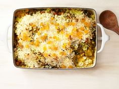 In this Curried Chicken and Rice Casserole, tender pieces of curried chicken and vegetables are layered at the bottom of a casserole dish, and the coconut rice is spread on top before baking.