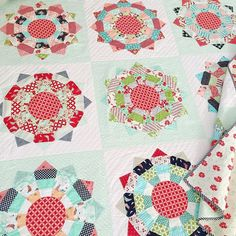 This Hello Darling quilt was probably my favorite one to piece of the new patterns, because I love dresdens, strip piecing, and mixing two fabric lines- and this has all of the above. Plus, navy stripe binding!! ;-) Can't go wrong there, right?  Pattern: Piccadilly Circus Fabric: Hello Darling & Daysail (2 Jelly Rolls) Quilting: @kwilter100 (thanks Nicole!!) #hellodarlingfabric #thimbleblossoms