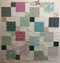 "Using a 10"" precut fabric layer cake, create TWO baby quilts in a weekend. This fast disappearing 9-patch patterns will be a favorite. By Jen Eskridge"