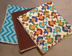 And... little boy monkeys, too!  Along with a large aqua chevron and a mini brown chevron.  These are the softest designer flannel.  Backed with chenille and double top-stitched, too.