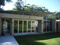 reminds me of mid century modern house of my childhood.  nice use of concrete and glass...clean lines