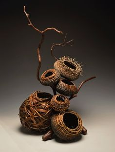 Matt Tommey's Art Baskets. Matt's handcrafted baskets are a whimsical collaboration of traditional Appalachian forms and wild, rustic, natural materials including natural vines (kudzu, honeysuckle, bittersweet, wisteria, grapevine) and bark (poplar, hickory, mimosa and others). His interpretation of rib baskets and other traditional shapes offer a heartfelt nod to his roots in Appalachian basketry while offering a contemporary expression that is all his own.