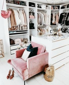 Glam closet with pink chair.
