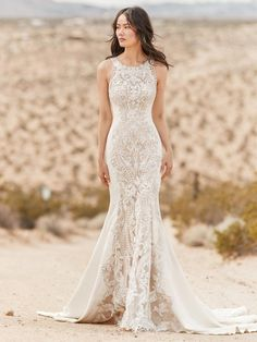 This sexy wedding dress is composed of Aldora crepe, with layers of sheer lace and lace motifs along the front and back, drifting into a statement hemline. Lace motifs adorn the sheer halter neckline and halter back. Lined with Virtue jersey for a luxe fe Western Wedding Dresses, Sexy Wedding Dresses, Designer Wedding Dresses, Bridal Dresses, Wedding Gowns, Elegant Dresses, Sexy Dresses, Summer Dresses, Formal Dresses