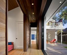 Striking Retractable Walls for Spacious Interior Ideas: retractable walls for hall design with wood flooring and wood walls also recessed lighting and balcony railings with wood decks