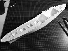 Hull and forward deck in a temporary fitting.